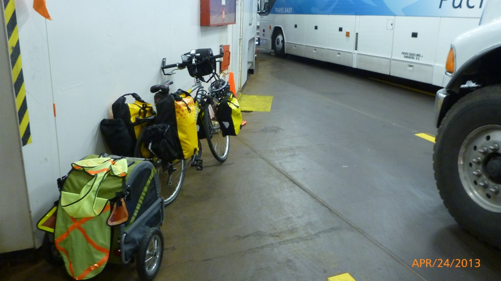 My bike on the trailer with the buses and transport trucks