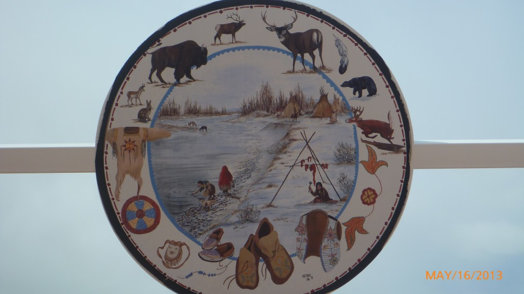 Some of the artwork painted on the circles within the World's Tallest Tippee depicting some of the past of First Nations people