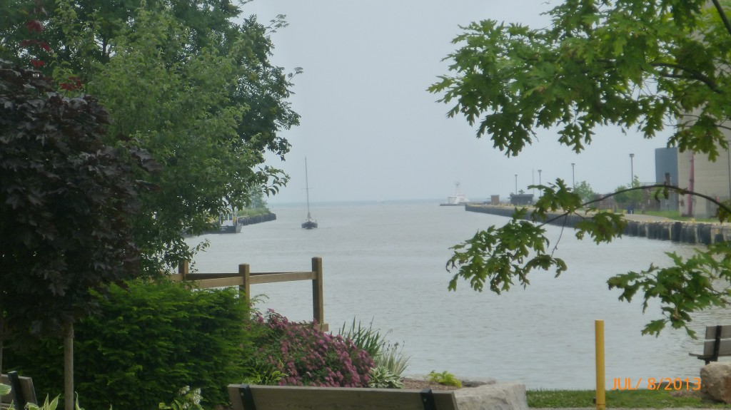 Watching a sailboat come in the river in Port Stanley