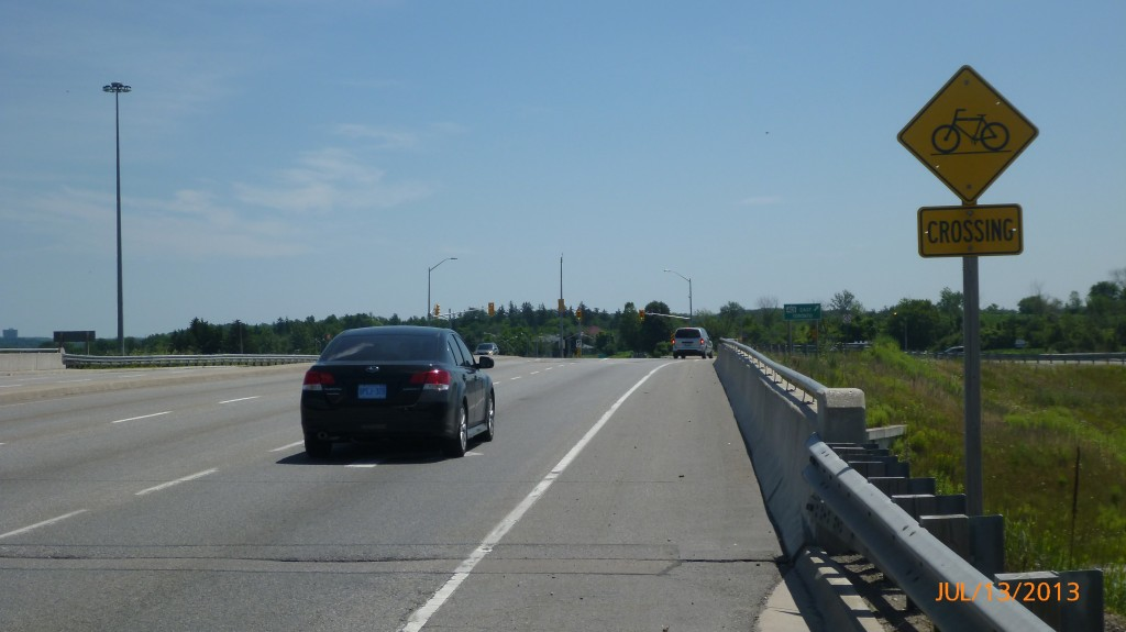 I appreciated both the bicycle path and crossing sign on the Homer Watson 401 overpass