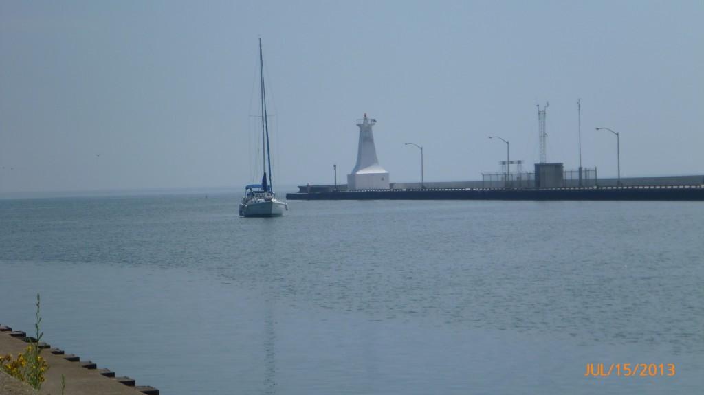 Sailboat waiting to pass the lift bridge