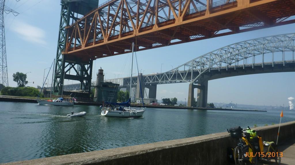 Lift bridge up and two sailboats passing through