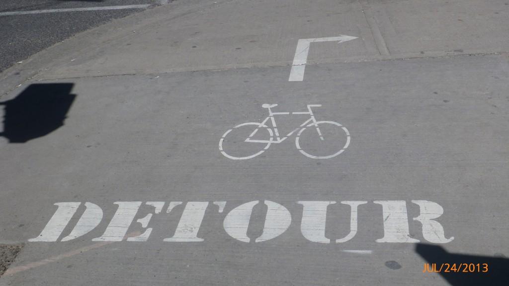 More bike detour signage navigating the construction on Queens Quay, Toronto
