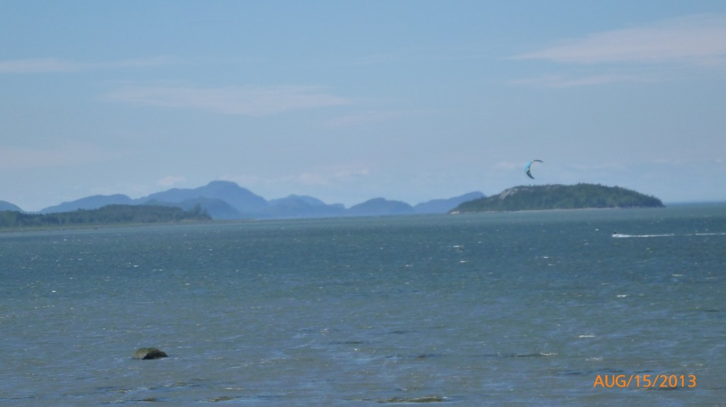 Watching a kite surfer with a scenic backdrop