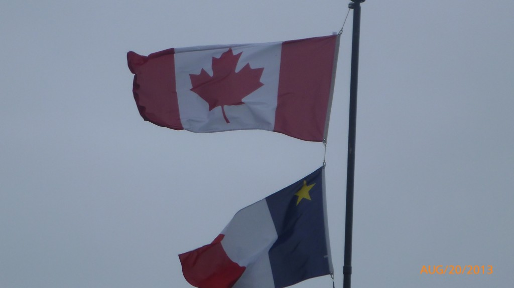Canada flag and acadian flag