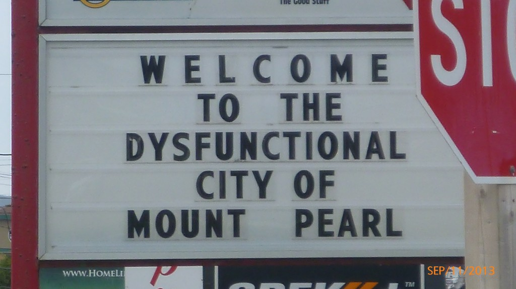 I don't know the story behind  why Mount Pearl is dysfunctional, just thought the sign was funny